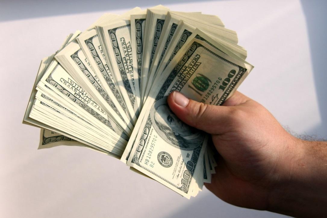 Доход в долларах